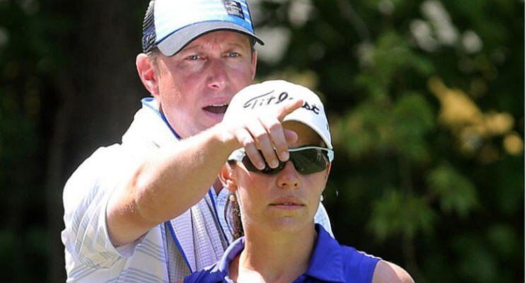Bruce giving golf instructions to my friend Joanne.